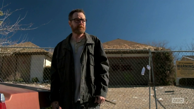 Breaking Bad S5E9 Walt outside the boarded-up house